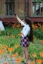 Girl- schoolgirl with long hair in school uniform makes selfie