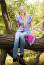 Pretty young girl on a tree Royalty Free Stock Photography