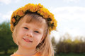 Pretty young girl wearing dandelion flower wreath garland crown around her head Royalty Free Stock Photography
