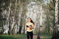 Pretty young girl weat in training clothes running in the park Royalty Free Stock Photo