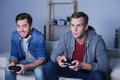 Pretty young guys are playing video games Royalty Free Stock Photo