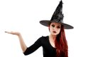 Pretty young happy woman smiling and dressed as a fairy or witch for halloween party show open palm with copyspace Royalty Free Stock Photo