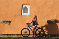 Pretty young hipster blonde girl posing with sport bicycle Royalty Free Stock Photo