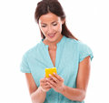 Pretty young lady reading text message using a yellow cellphone in white background Royalty Free Stock Image