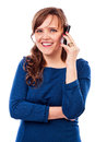 Pretty young lady speaking on the phone and smiling against white background Stock Photo