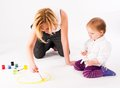 Pretty young mother and daughter drawing Stock Image