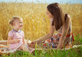 Pretty young mother reading book to her little daughter Royalty Free Stock Photo