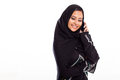 Pretty young muslim woman talking mobile phone Royalty Free Stock Photo