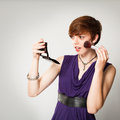 Pretty Young Red-Haired Woman Applying Makeup Royalty Free Stock Photography