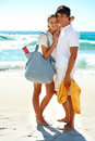 Pretty young woman on the beach with her boyfriend Stock Photography