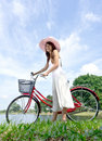 Pretty and young woman with bicycle Royalty Free Stock Image