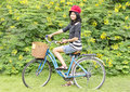 Pretty young woman with bicycle in a park smiling portrait of outdoor Royalty Free Stock Photos