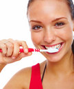 Pretty young woman brushing her teeth isolated Stock Photography