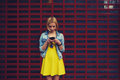 Pretty young woman chatting on her smartphone against blank copy space bright background for your content or text message female Royalty Free Stock Images