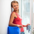 Pretty, young woman doing house work Royalty Free Stock Photo
