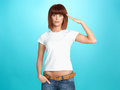 Pretty young woman doing military salute Royalty Free Stock Photo