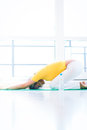 Pretty young woman doing yoga exercise at home Royalty Free Stock Photo