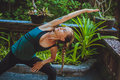 Pretty young woman doing yoga outside in natural environment Royalty Free Stock Photo