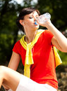 Pretty young woman drinking water in the park Royalty Free Stock Photo
