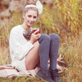 Pretty young woman girl drinks tea in retro clothes enjoying autumn day Stock Images
