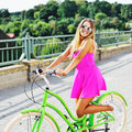 Pretty young woman having fun on a bicycle Royalty Free Stock Photo