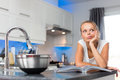 Pretty, young woman in her modern, clean and bright kitchen Royalty Free Stock Photo