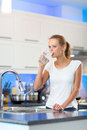 Pretty, young woman in her modern kitchen Royalty Free Stock Photo