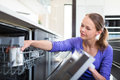 Pretty, young woman in her modern and well equiped kitchen Royalty Free Stock Photo