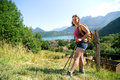 Pretty young woman is hiking in mountains the french alps Stock Photo