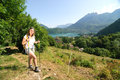 Pretty young woman is hiking in mountains the french alps Royalty Free Stock Photo