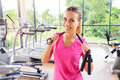 Pretty young woman holding jump rope Royalty Free Stock Photo