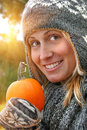 Pretty young woman holding a pumpkin Royalty Free Stock Image