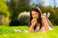Pretty young woman holding yellow flowers smiling some happily Stock Photo