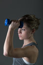 Pretty, young woman lifting dumbbells Royalty Free Stock Photography