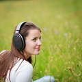 Pretty young woman listening to music Stock Photography