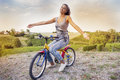 Pretty young woman on little bike Royalty Free Stock Photo