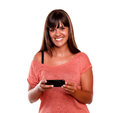 Pretty young woman looking at you using mobile Royalty Free Stock Images