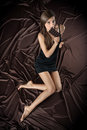 Pretty young woman nibbling the bar of chocolate Stock Images