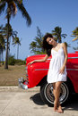 Pretty young woman and old red car Royalty Free Stock Photo