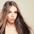 Pretty Young Woman with Perfect Skin and Long Healthy Hair