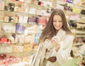 Pretty young woman in perfumery the Stock Photography
