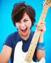 Pretty young woman playing a guitar and singing Royalty Free Stock Images