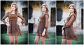 Pretty young woman posing in front of the farm very attractive blonde girl with brown short dress romantic young woman posing Stock Photos