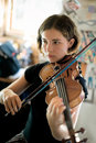 Pretty Young Woman Practicing Violin Royalty Free Stock Photos