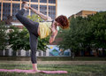 Pretty Young Woman Practicing Yoga in the Park Royalty Free Stock Photo