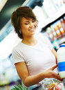 Pretty young woman purchasing grocerys Stock Image