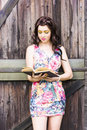 Pretty Young Woman Reading Book Stock Image