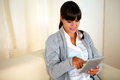 Pretty young woman reading a message on tablet pc Royalty Free Stock Photo