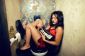 Pretty young woman in restroom with money like prostitute laughting Royalty Free Stock Photos