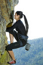 Pretty Young Woman Rock Climbing Stock Photography